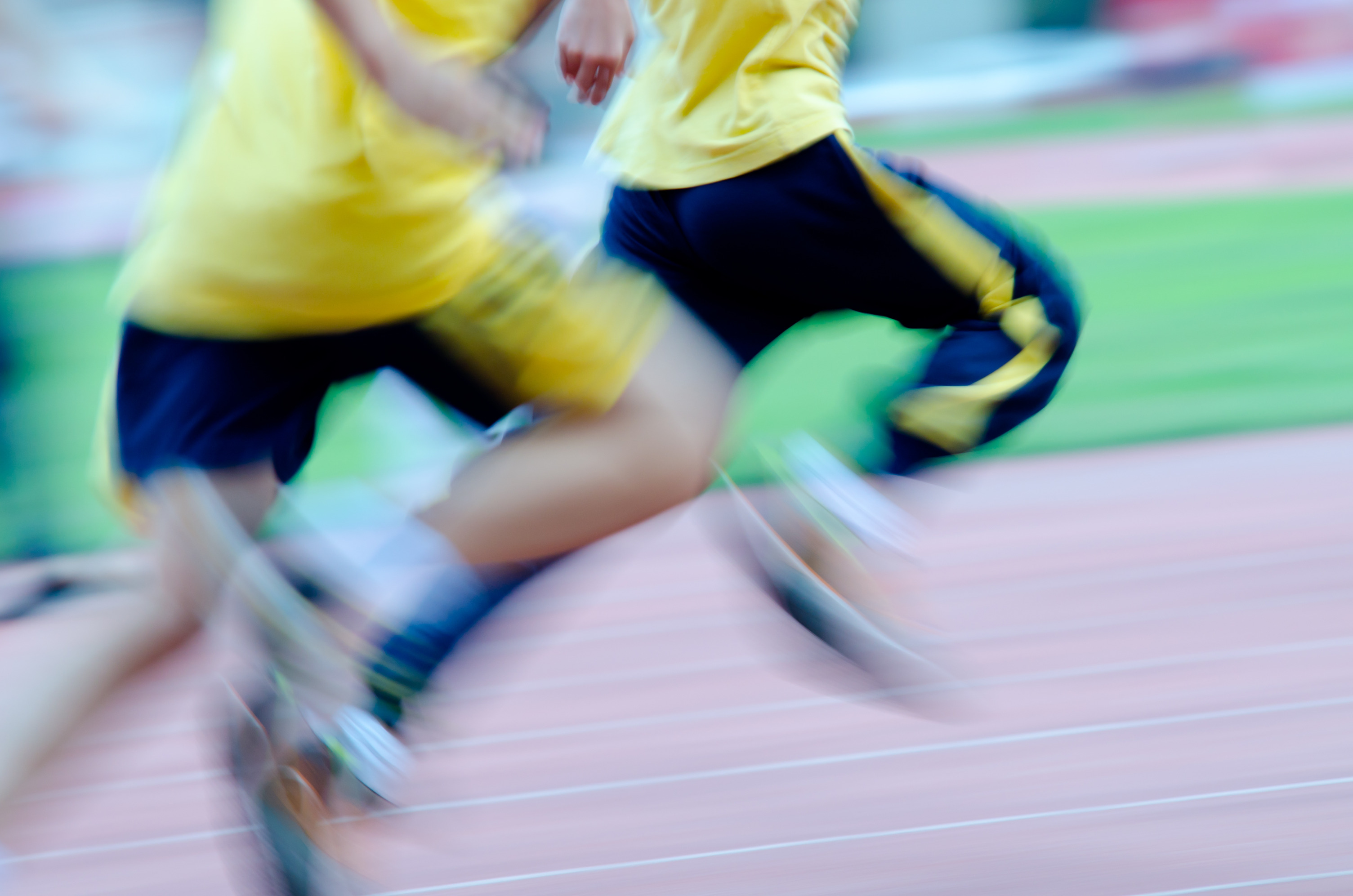 photodune-4378503-running-child-on-sport-track-blurred-motion-l